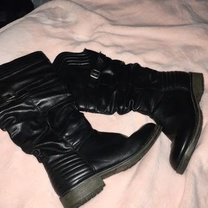 Black knee-high boots with buckles